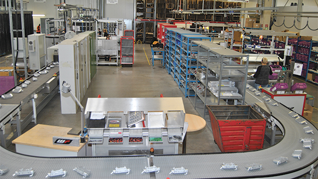 Separating the A parts from the lower quantity varieties and building them in a cyclic flow production along a U-shaped conveyor allowed WP Components to increase output by 40 percent without requiring more room or extra workers.