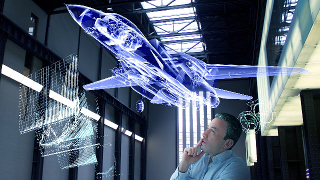 Aerospace engineer studying the digital twin aircraft design simulation of his aircraft design