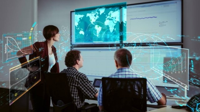 Woman and two men looking at graph and global map with data points digitally layered