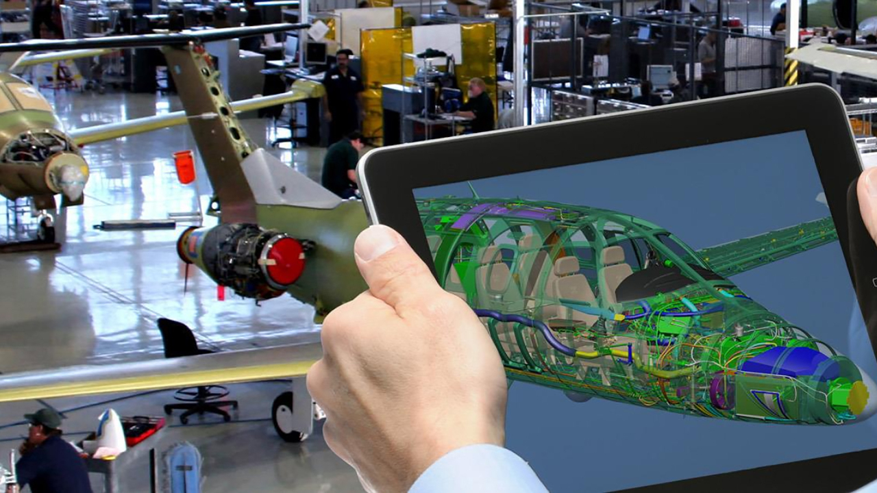 Aerospace Engineer viewing the digital twin of an aerospace and aircraft design