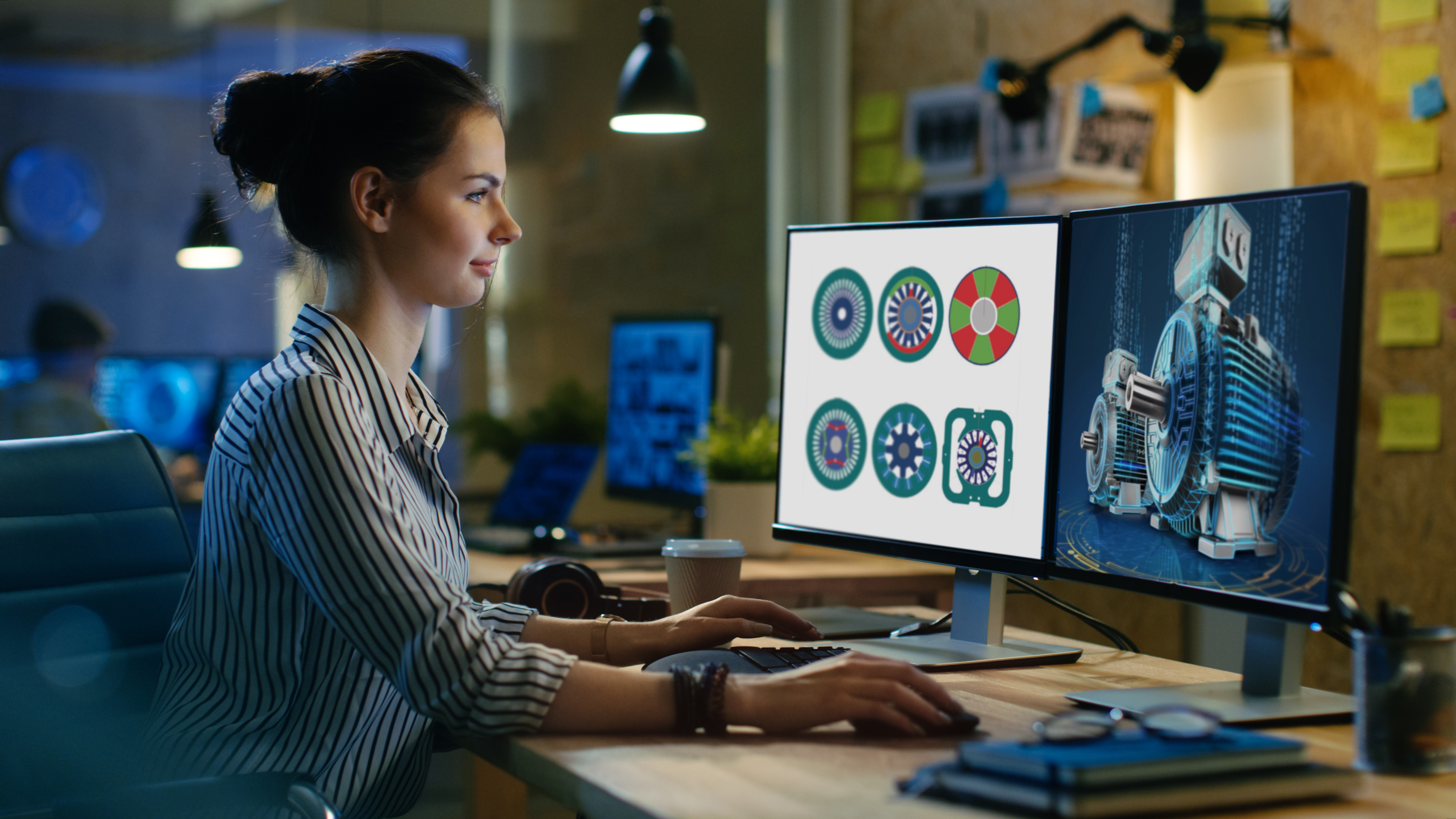 A woman engineer looking at the monitor working in Simcenter Speed Software