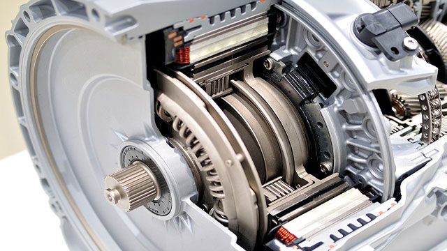 The cross-section view of an automatic transmission shows the torque converter clutch component that is responsible for clutch judder.