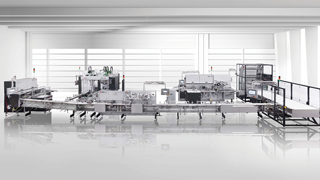 Packaging system with high-performance flow and fold wrapping machines for chocolate bars.